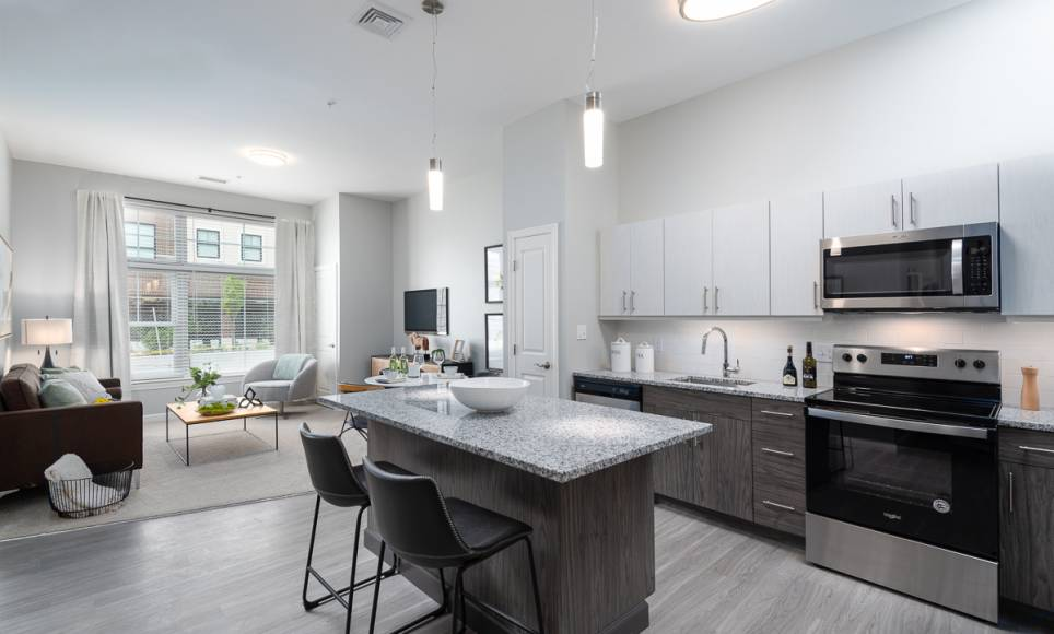 One Wall St Kitchen with granite countertops stainless steel appliances large window and living room