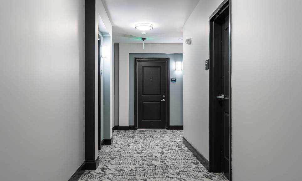 Hallways to the apartments at One Wall St in Attleboro.